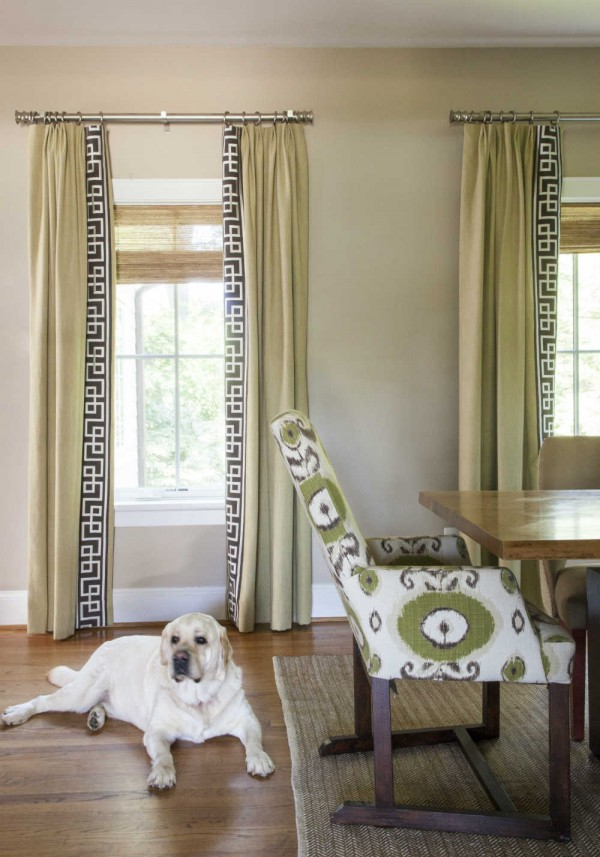 Suzanni fabric on the captain's chairs, Greek key detailing on the drapes and a handsome hound complete the look. </br>(Arlington, Virginia)