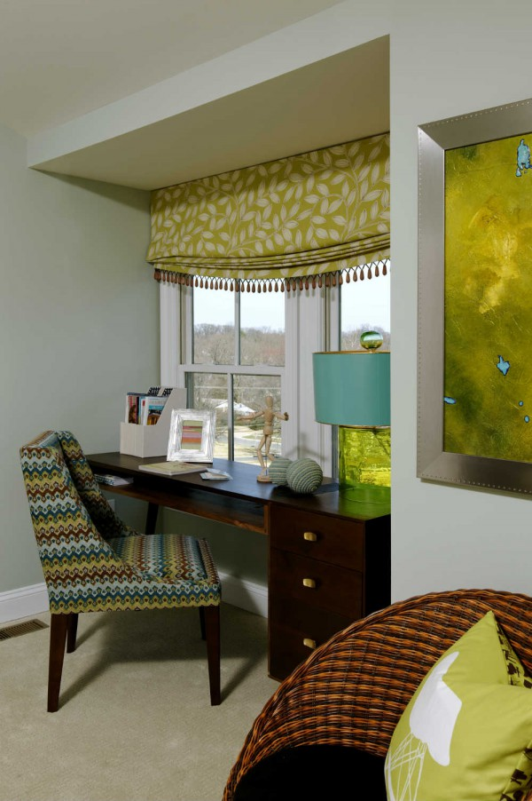 Wooden tassle trim, a lively mix of patterns and a textural glass lamp add earthy style to a study area anchored by a mid-century style desk. </br>(Bethesda, Maryland)