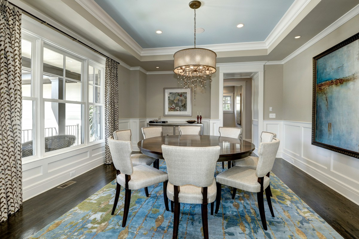 Creative use of paint and mouldings, a round dining table, and unique light fixture  keeps conversation lively in this suburban dining room. </br> (McLean, VA)
