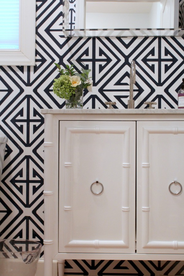 Graphic wallpaper delivers dramatic impact in the powder room.	</br>  (Arlington, VA)