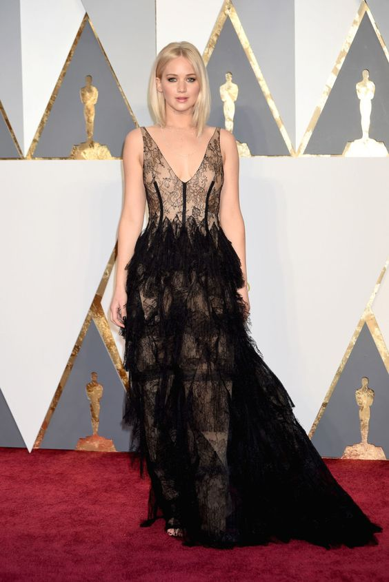 Golden-skinned Jennifer Lawrence in fluffy, black Dior