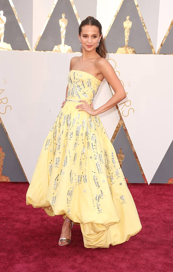 Sunny and bright Alicia Vikander in an interestingly shaped Louis Vuitton