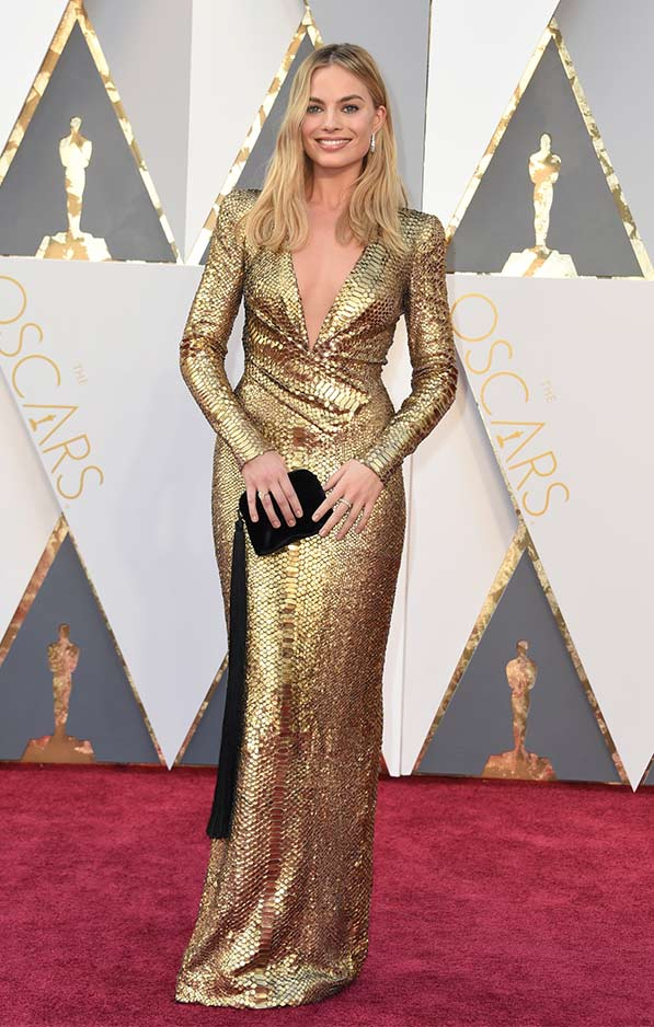 Margot Robbie in scaled gold Tom Ford