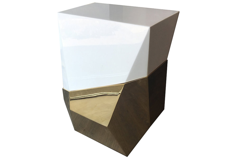 Two-tone, modern edge side table cuts a striking figure.