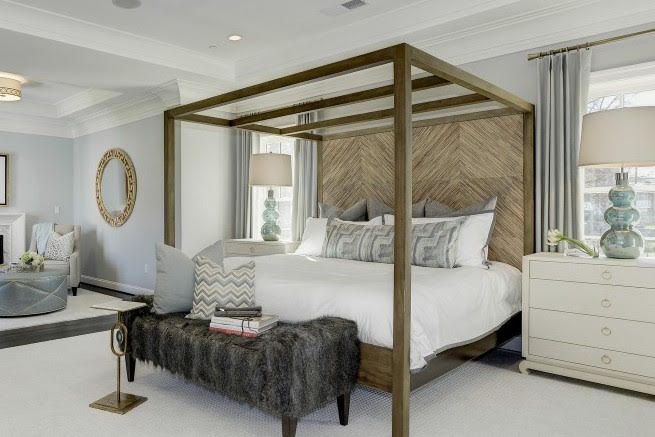 Natural wood graining is highlighted in a chevron pattern on this eye-catching headboard. (Room by Whittington Design Studio)
