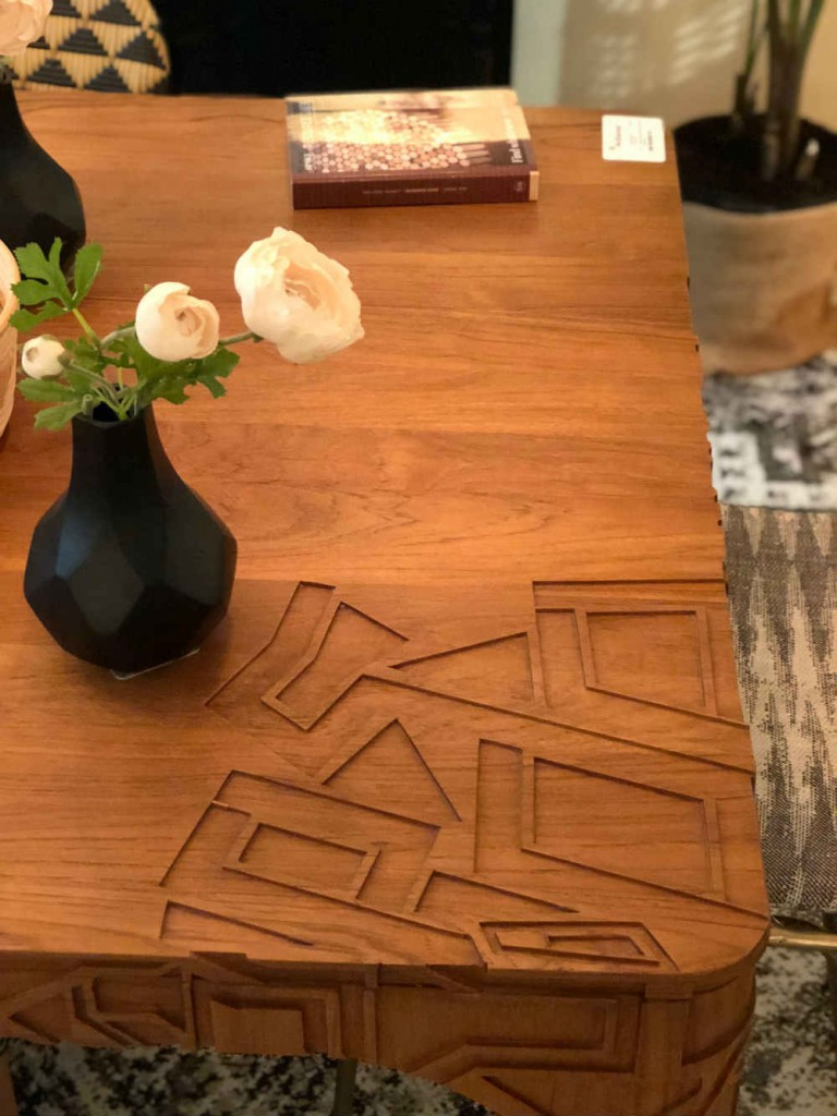 Carved corner detailing adds pizzaz to a teak dining table from Selamat Designs.